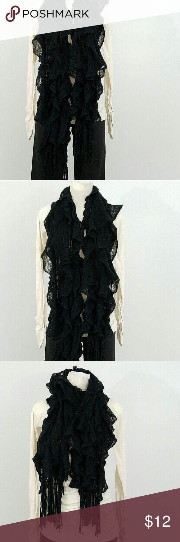 Black Frilly Scarf Very soft, 100% acrylic loose knit scarf. There are 4 rows attached to the base knit. This gives it a very feminine appearance and adds bulk to help keep warm. Accessories Scarves & Wraps