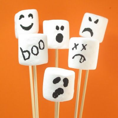 How cute are these spooky marshmallows?      Use a black gourmet writer pen.  Make sure marshmallows sit out at room temperature for a few hours to stiffen the outside so it is easy to draw on the marshmallows.
