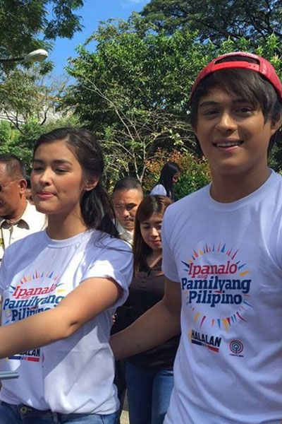"""This is the lovely Liza Soberano and the handsome Enrique Gil visiting students at University of Santo Tomas during the taping of the 2016 ABS-CBN Summer Station ID and Halalan 2016 Station ID theme song, """"Ipanalo ang Pamilyang Pilipino!"""" They encouraged the students at University of Santo Tomas to vote wisely on Halalan 2016. #ABSCBN #Halalan2016 #IpanaloangPamilyangPilipino #LizaSoberano #AteHopie #EnriqueGil #LizQuen"""
