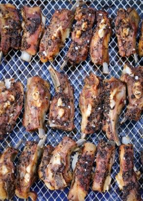 Lamb Ribs With Nigella And Cumin Seeds: Stop what you're doing: I bring you important news. Lamb ribs, almost unknown in Britain, are one of the most delicious ways of eating lamb, and certainly the least expensive. Not that they taste bargain-basement: everyone who's eaten these has said they're the best spare ribs they've ever had.