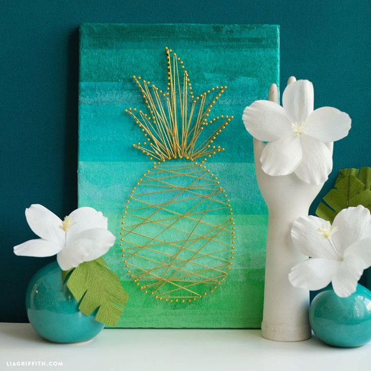 This tropical wall art project features a string art pineapple in gold with an ombre background. Make one for beach house or home decor to welcome guests! MichaelsMakers Lia Griffith