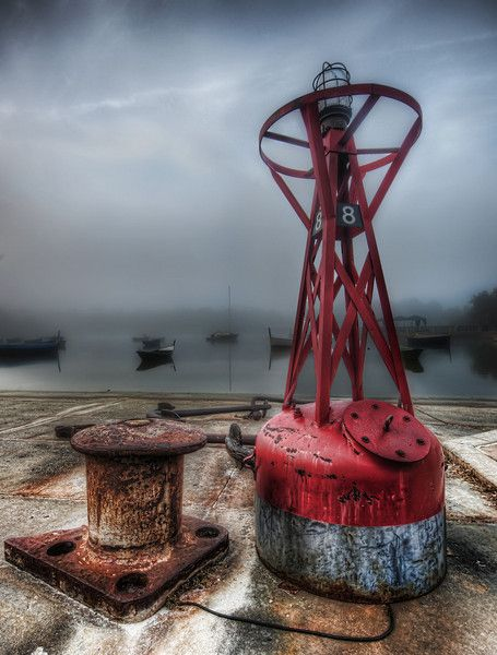This is very early morning with a dense fog over this little harbor. I loved the details on these bits, so I did my best to capture them in the morning wetness. In the distance, you can see the anchored boats.  - Orlando, Florida  - Photo from #treyratcliff Trey Ratcliff at http://www.StuckInCustoms.com