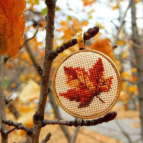 "The pendant ""Autumn Leaf"" is handmade item with miniature #crossstitch (size of one microstitch is less than 1mm). Size of pendant 29x29mm, colour of the frame is gold. The ... #leaf #autumn #yellow #orange #plant #embroidery #nature"