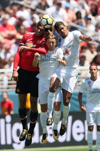 Marouane Fellaini of Manchester United heads the ball with Luka Modric and Raphael Varane of Real Madrid during the International Champions Cup 2017...