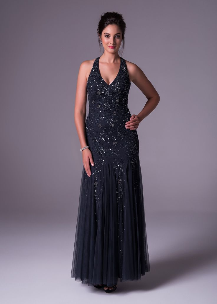 A midnight blue soft & slim fully beaded halterneck dress with unique godet skirt detailing. Be sure to shimmer and shine in this Oleg Cassini creation available exclusively to Bride&co: http://www.brideandco.co.za/product/new-collection/wgin0018/