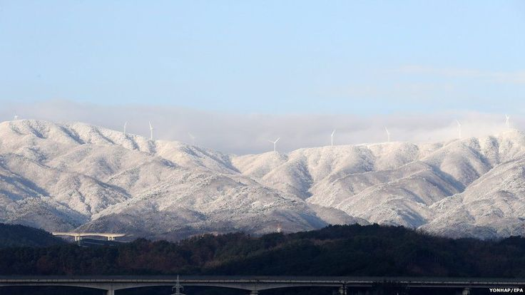 Mountains near the port city of Sokcho, South Korea, are covered with snow on 6 January, following heavy snow overnight.