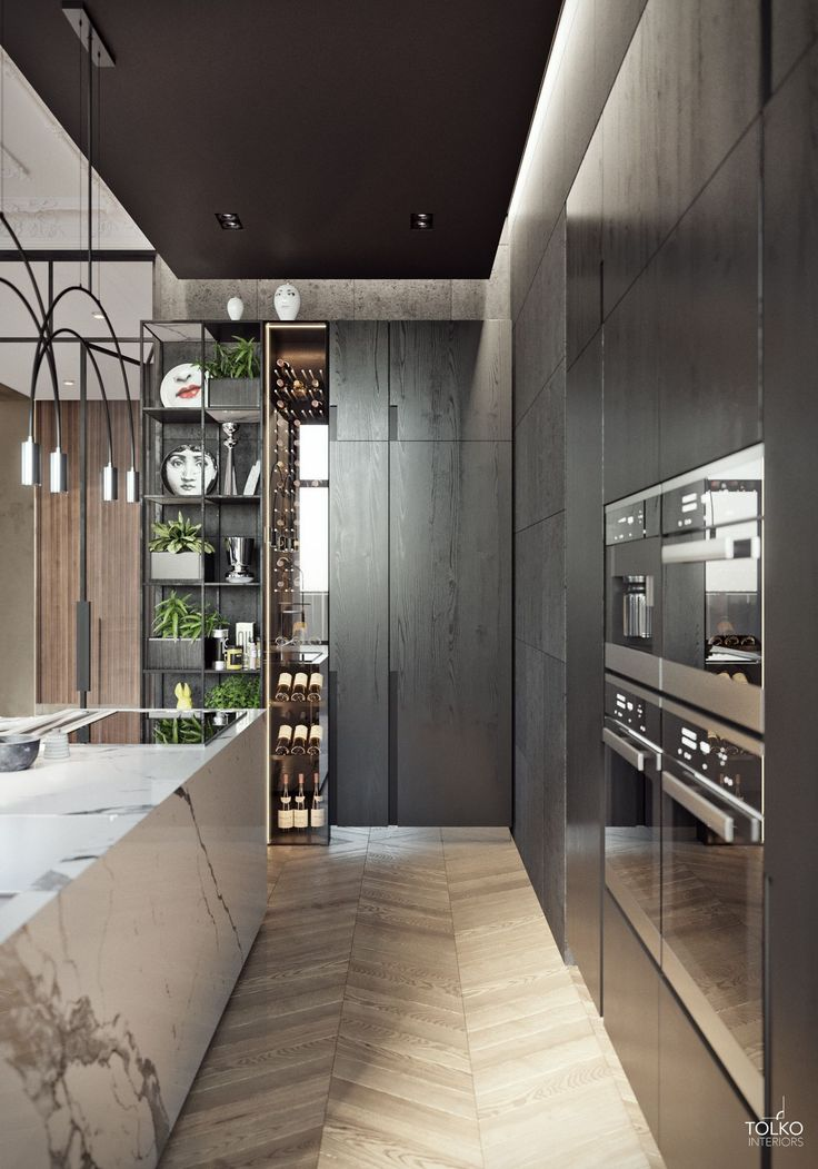 Luxurious modern apartment / KITCHEN. White marble block kitchen island with dark wood cabinetry and thin tall wine display and storage. Love the shelves with storage space too <3