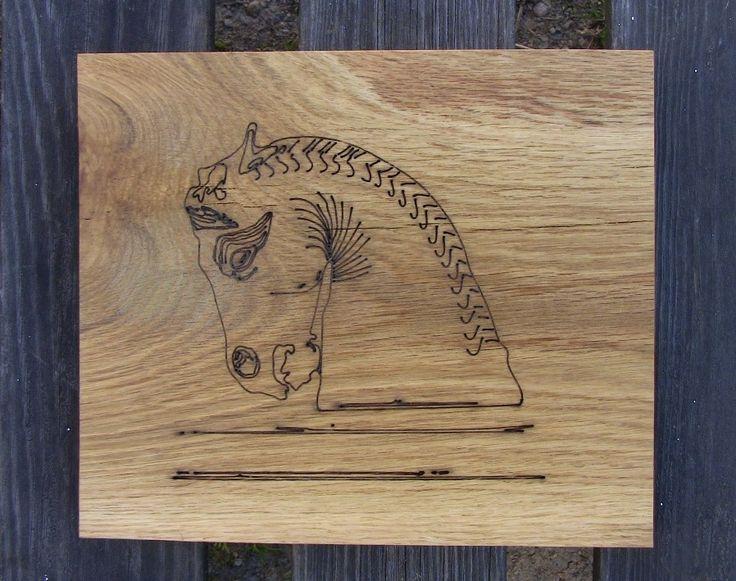 Antique horse on solid oak. (Motiv på antik häst på massive ek) hastohem.se