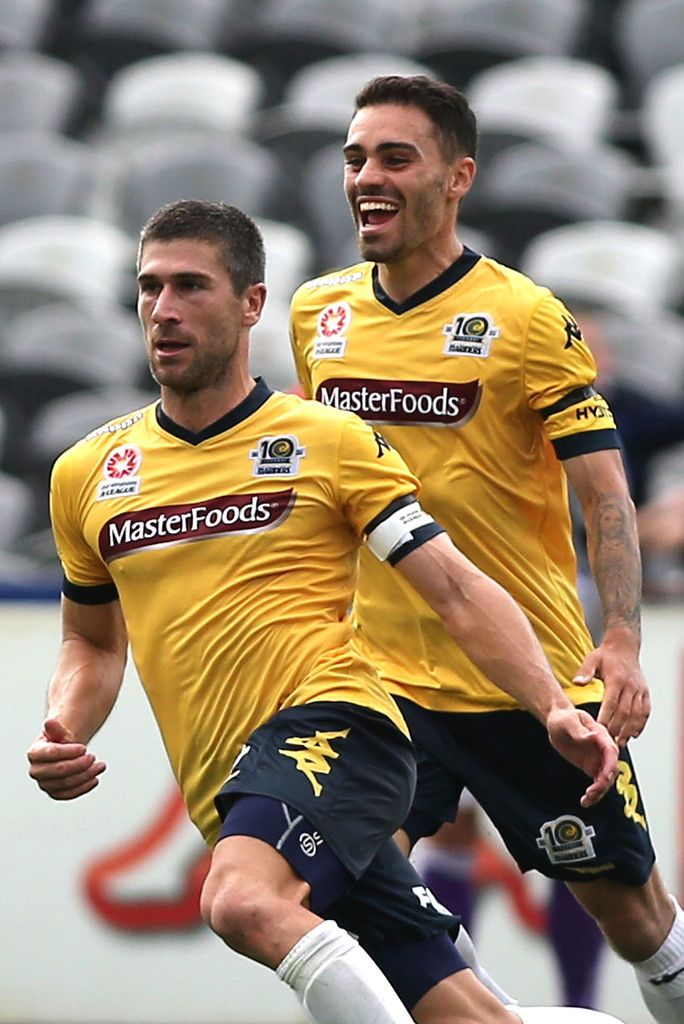Anthony Caceres : Nick Montgomery (L) of the Mariners celebrates a goal with team mate Anthony Caceres during the round 22 A-League match between the Central Coast Mariners and the Perth Glory at Central Coast Stadium on March 22, 2015 in Gosford, Australia.