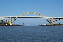 Google Image Result for http://upload.wikimedia.org/wikipedia/commons/thumb/2/25/Hoan_Bridge.jpg/250px-Hoan_Bridge.jpg      the lakefront, when summerfest had no permanent buildings there, and when there was no hoan bridge there...and when the hoan bridge went nowhere!