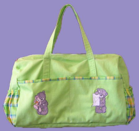 Baby bag with tatty bear embroidery designs. Love the lime green fabric I used to make this bag