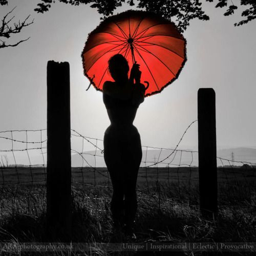 Silhouette black white with a touch of color photography red umbrella