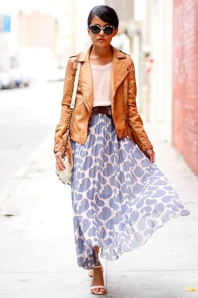Tan leather jacket, maxi skirt, simple tee, cross-body bag, and sandals.