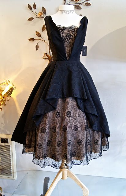 """This dress simply draws me...I imagine a countess who's just thrown off her title and run through the woods to escape her planned destiny...or a """"Black Widow"""" type attempting to woo her late husband's best friend, a detective, with alluring couture and some sobs...me too many books."""