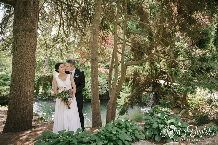 Bride and groom snuggle by a waterfall. James Gardens, Toronto wedding photography.
