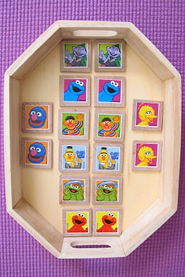 DIY Matching/Memory Tile Game. Stickers and wood tiles from the craft store. Cost: about 2 dollars!