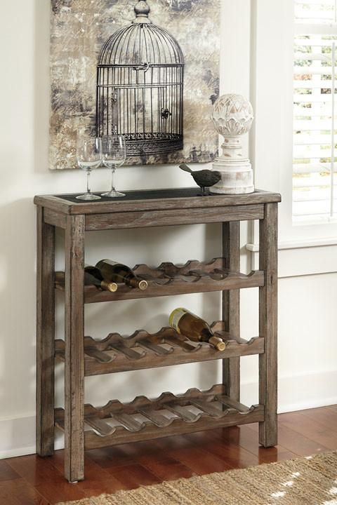 With its rustic design and brushed grey-brown finish, this warmly weathered wine rack adds a vineyard-chic touch to your dining room or home bar