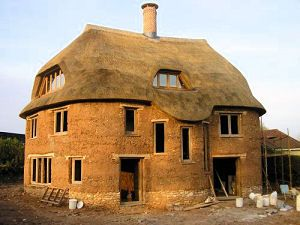 This home was built by Kevin McCabe, of Devon. He built the first cob home in over 70 years in England, and yes, it's a 3 story home! The walls are 1 meter thick and virtually sound-proof. The roof is thatch and though it looks amazing.