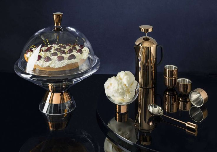Cake stand - tank   Simon James Design    Designed by Tom Dixon    New from Tom Dixon is the glass Cake Stand. An oversized, elegant cake stand perfect for serving cake, or to store food in the kitchen. Made from mouth-blown glass with hand-painted copper detailing, team with matching pieces in the Tank collection to complete the look.