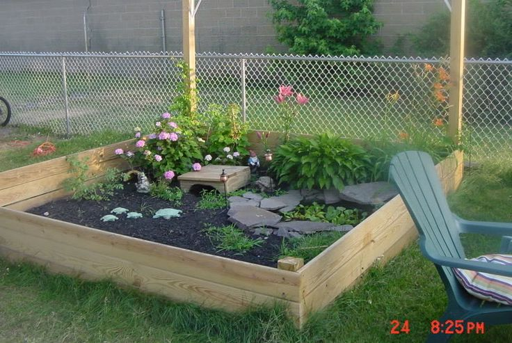 Beautiful outdoor tortoise habitat using a raised bed for a garden.