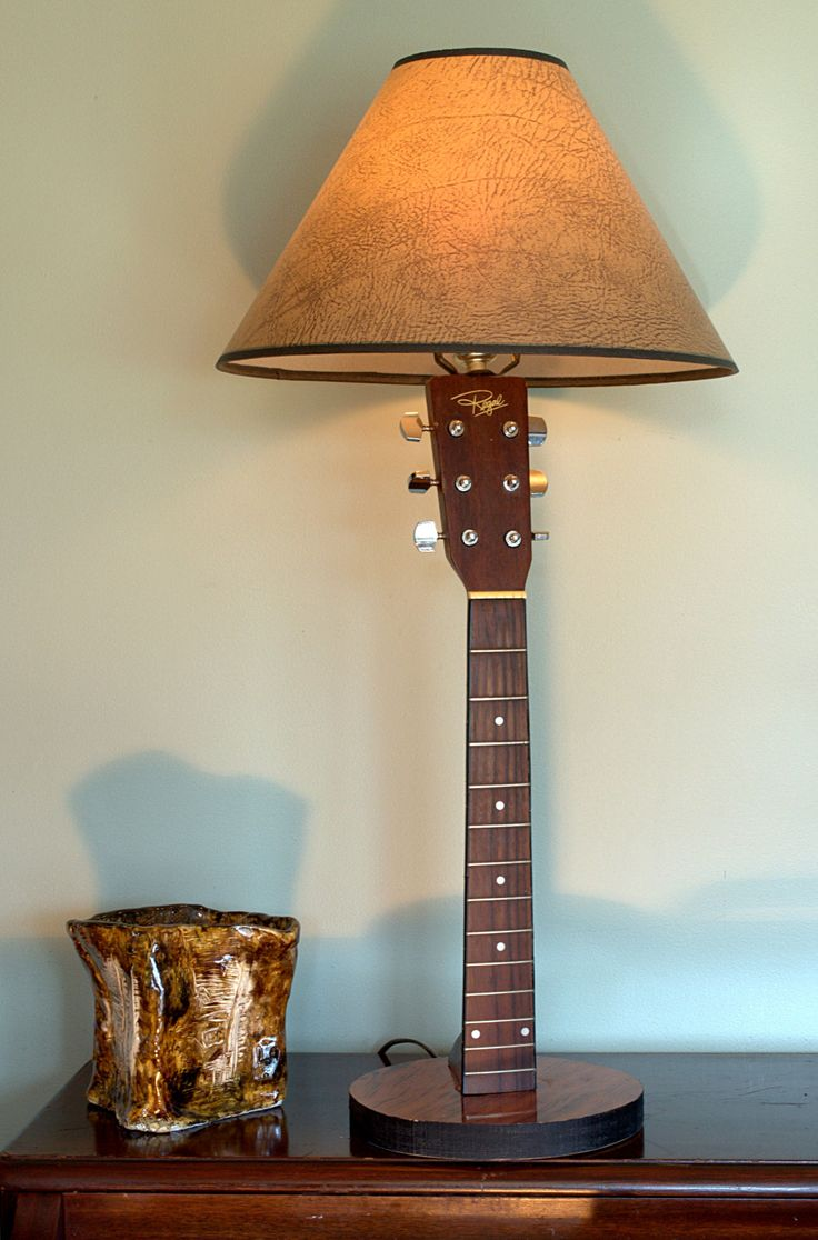 This lamp was made from the neck of a broken acoustic guitar. It seemed a shame to throw it away, so I made it into this really cool guitar lamp. This lamp has a 9 inch diameter base, and is aprox. 30 inches tall. It has a 3-way switch for different lighting conditions.      This guitar neck is not new, and as such, has various minor signs of normal use. The lampshade is not included with the lamp, however one of your choice can be easily found at your local store that will fit into your…