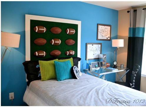 Using footballs to make a headboard is a great idea in this boys bedroom.