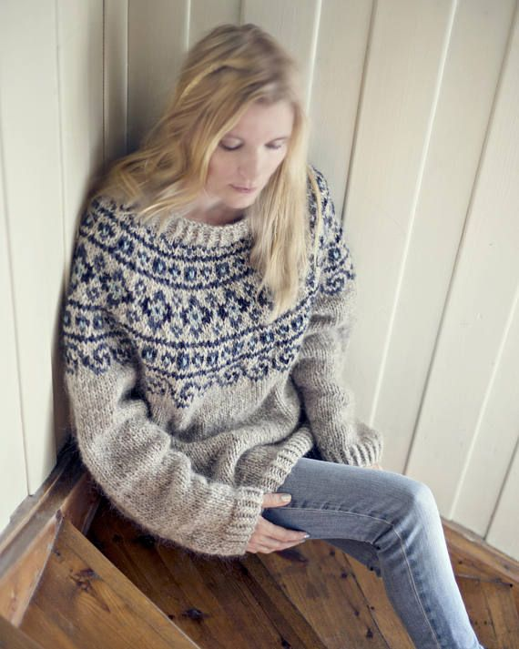 "Knitting pattern PDF for a beautiful and warm Nordic sweater. Knitted with beautiful icelandic yarn, this warm seamless sweater with a ""naive"" blue pattern is inspired by designs from old Norwegian clothing from Setesdal, a valley that has among the richest and best kept arts and crafts traditions in Norway. Knits up quickly! Written pattern with pictures and chart. Pattern for one size L (boyfriend size) sweater. Circumference chest approx. 113 cm - 44,5 inches Knitting gauge: 12 sts in…"