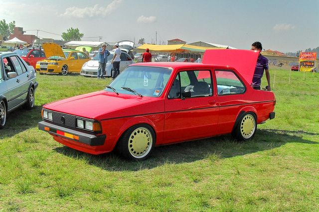Satin red Feuerwehr VW Jetta Mk1 2 door coupe at the W rthersee Tour