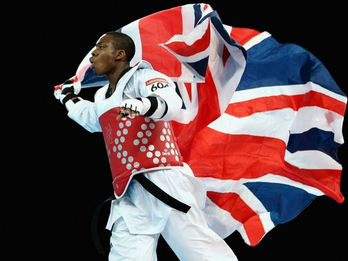 Great Britain's taekwondo fighter Lutalo Muhammad made the most of his controversial selection to the team by claiming an Olympic bronze medal.