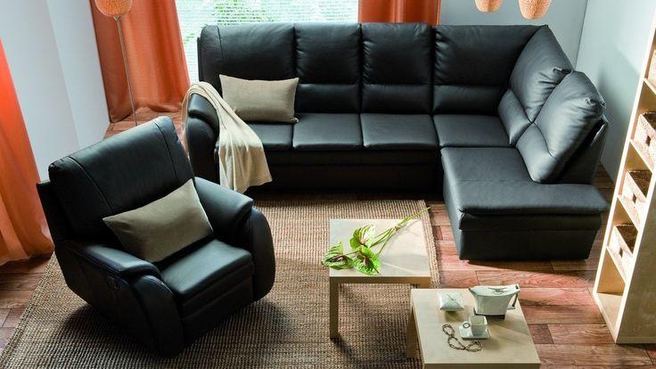 Rozłożysty zestaw wypoczynkowy składający się z narożnika i fotela. Meble skórzane wysokiej jakości.