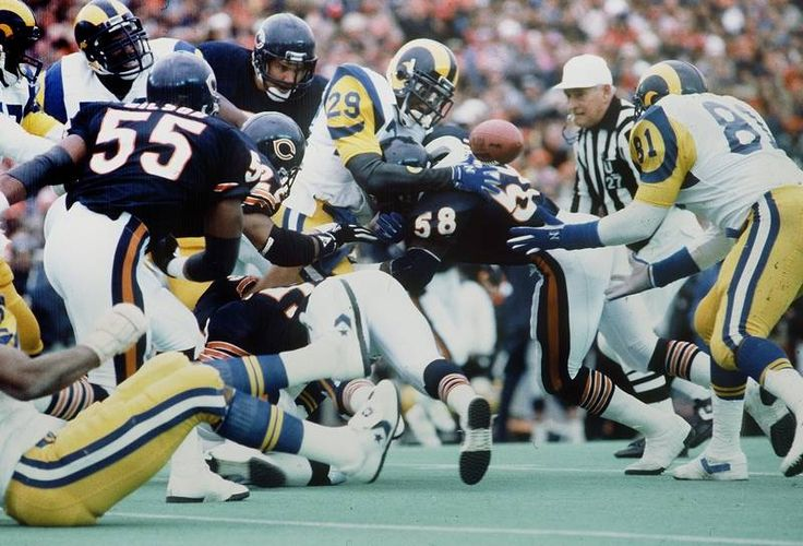 Otis Wilson, Wilber Marshall and Steve McMichael corral Eric Dickerson, NFC Championship Game. January 12, 1986 Soldier Field, Chicago, Illinois.