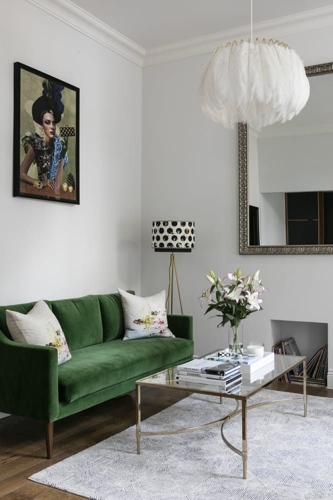 Love the beautiful velvet texture of the green couch, the polka-dot tripod lamp, and the high ceilings.