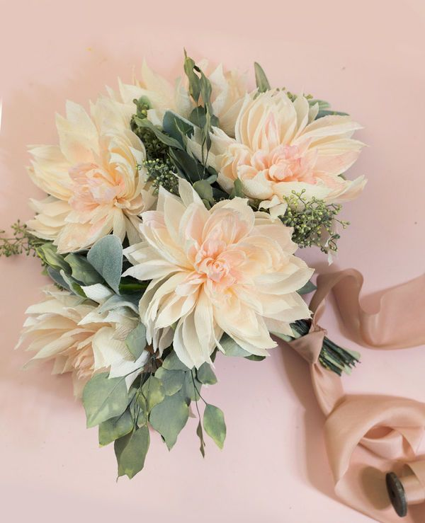 Paper Dahlia Wedding Bouquet: Your eyes doth not deceive you— this blossom-filled bouquet is made entirely from paper. The delicate detail here is so exquisite, we keep catching ourselves expecting to get a whiff of the fragrant petals.