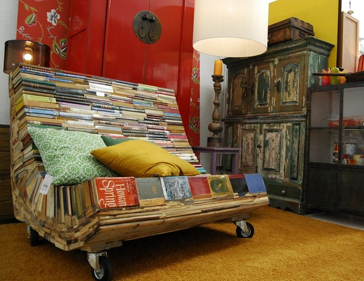 """Books recycled into the """"Bench of Thought"""" reading chair by Alvaro Tamarit."""