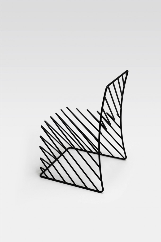 This design uses the simplicity of lines to create a chair that appears to be 3d. It evokes feelings of starkness. This chair doesn't look particularly comfortable or inviting.