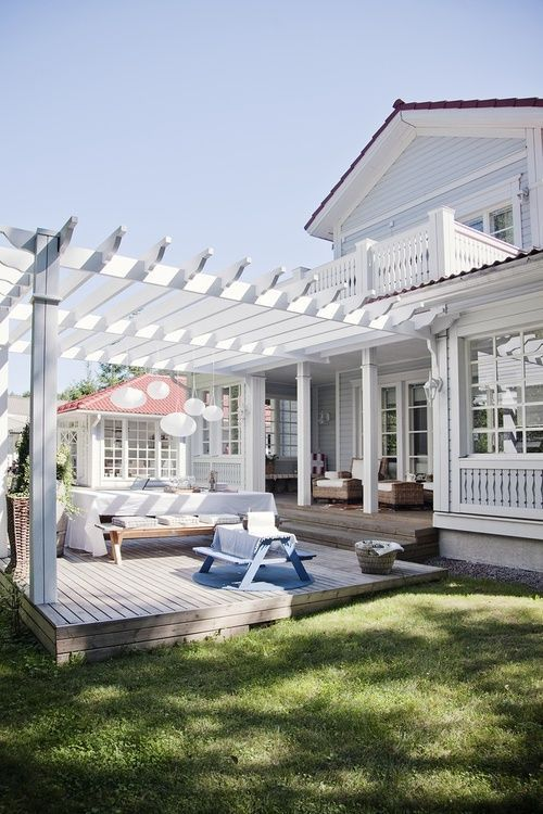 Pergola and deck, all painted white.