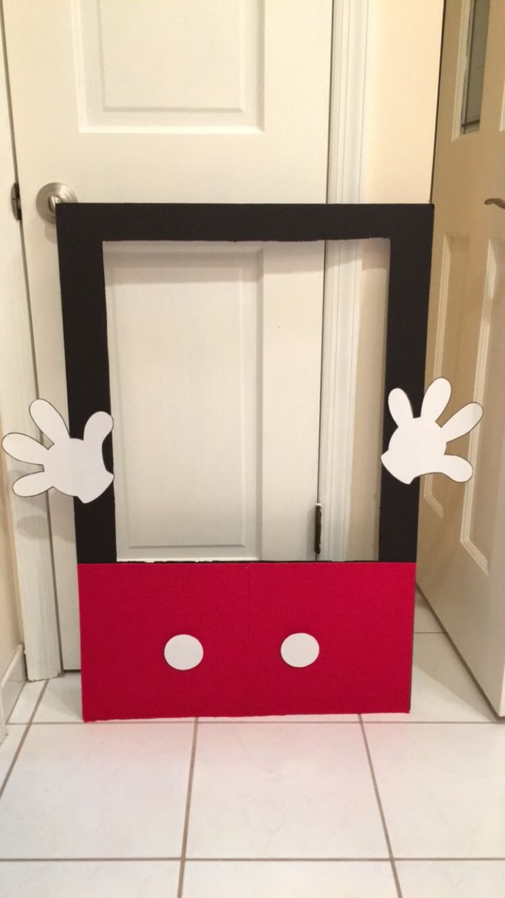 DIY Mickey Mouse Photo Frame Prop  poster board, glue gun, cardstock paper, felt! Thats all!  Mickey hands & round circles found on Pinterest for free download!