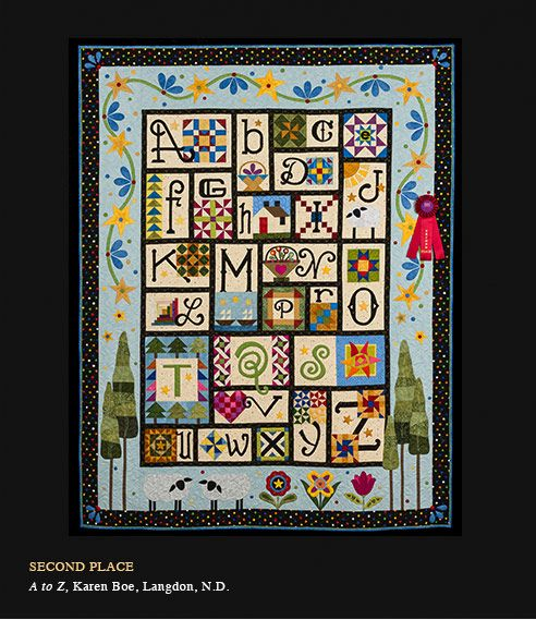 Quilting by Barb Simons of StoneRidge Quilting and pieced by Karen Boe.