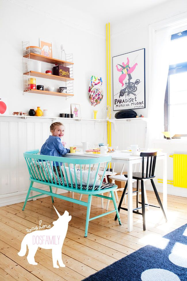 Love this space! Especially the turquoise Ercol and splashes of yellow.  Dining room. Modern Skandi home.