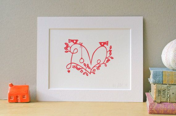 The print shows the word love, embellished with flowers, delicate, lace-y leaves and a pair of birdies. It would make a fantastic present for a