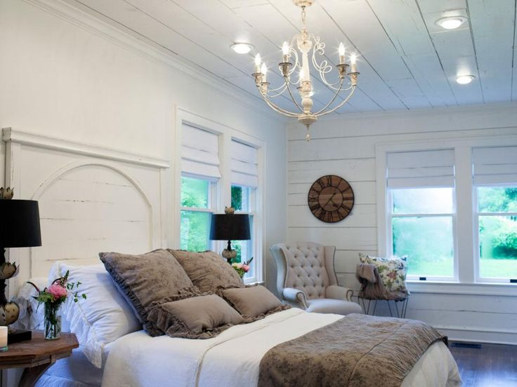 The statement piece in the bedroom is the custom headboard with arched design, echoing the new archways incorporated into the home's layout. The headboard was desinged by Joanna and fashioned by carpenter and furniture artisan Clint Harp. The shiplap on the ceiling and walls is original to the house and was exposed when old drywall was removed.