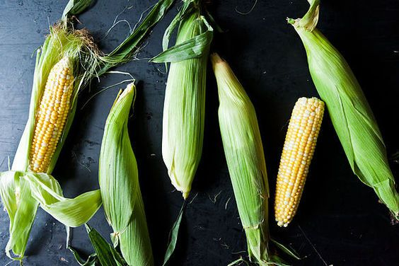 """How to Remove the Silk from an Ear of Corn microwave method: """"Cut a small slice off the stem end of un-husked ear of corn. Put a few ears in microwave on high for 30 seconds, the husk and silk should come off more easily. Then cook corn as desired."""""""