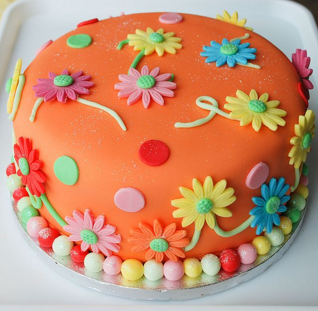Bright flower birthday cake by Grandmas cake toppers, via Flickr