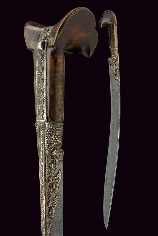 [Ottoman Empire] A Yatagan Single-Edged Blade with Rear Groove, Richly Engraved with Inscriptions in Arabic, 19th C.