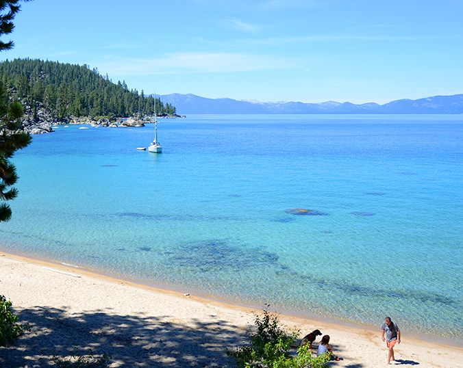 This Lake Tahoe beach is known as Boaters Beach on Lake Tahoe's east shore south of Incline Village Nevada. The vast views and sandy beach make this a favorite for boaters who want to anchor off shore. Just down from Secret Cove Beach you can adventure down the trail along the shoreline.