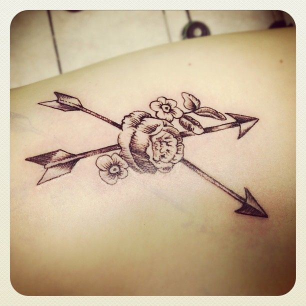 my crossed arrows with vintage flowers tattoo