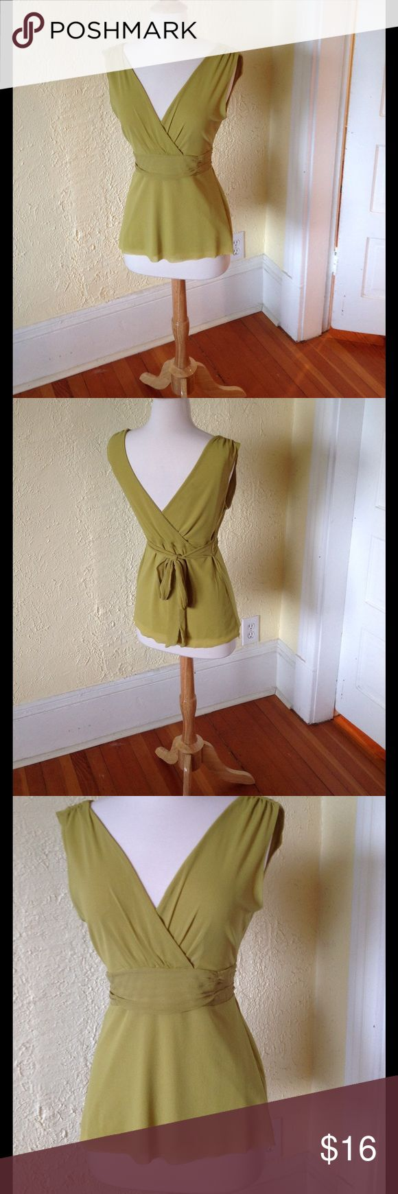 """ANTHROPOLOGIE Grecian Top by Weston Wear Rare find from very early 2000s. Double v neck pullover styling with tie back waist. Double layer of 100% silk. 17"""" bust, 14"""" waist, 25"""" long from shoulder. Anthropologie Tops Tank Tops"""