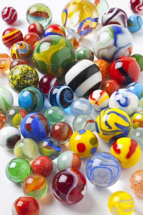 I played marbles - -not well at all, but I won a few purees,agates and cat-eyes!! And I had some steelies....Kept them in a linen pull-string money bag.