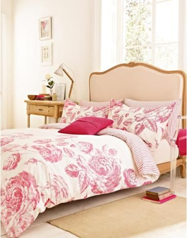 Joules Kensington Floral Duvet Cover, Pink.                     We've gone large with this beautiful, bold print of hand-drawn roses and wisteria.  A matching striped reverse complements the print perfectly.  Like nodding off in a sun-dappled country garden