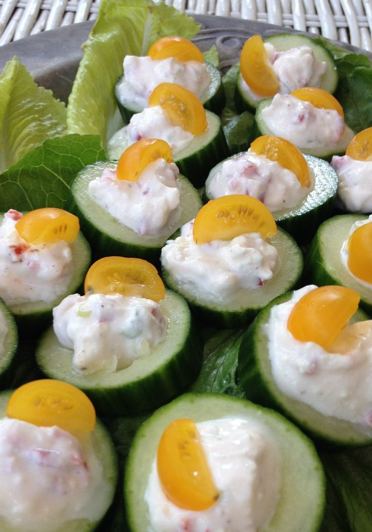 Cucumbers topped with Feta, yogurt, chili & scallion, garnished with tiny slices of yellow tomato. Fresh, light & perfect for summer parties...